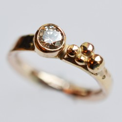 Rose gold band with yellow gold setting and a lovely sparkly light champagne diamond